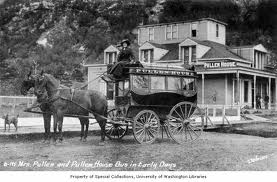 Harriet in front of her hotel with her new stage coach.